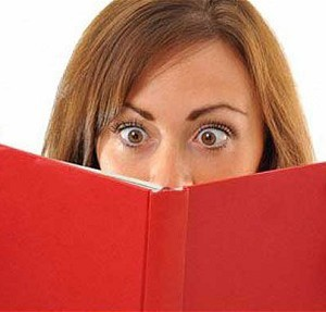 Woman looks intently at a book.