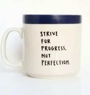 "coffee mug with ""Strive for progress, not perfection"""